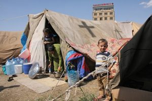 family_in_refugee_camp_in_yard_of_st-_elia_church_in_erbil_iraq-1