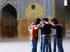 young-men-praying-outside-mosque-medium