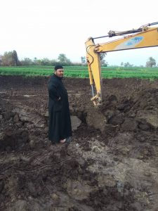 Fr Feltaws Ibrahim overseeing digging