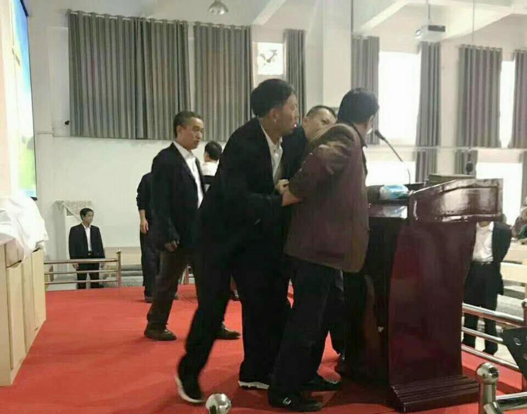 Henan pastor handcuffed
