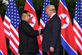 Presidents Kim and Trump shaking hands