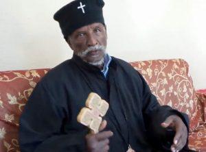 Patriarch Antonios holding cross