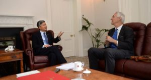 He Xiangdong, China's ambassador to Ireland, and Irish Times journalist Colm Keena