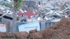 Tianmen Church cross amid rubble