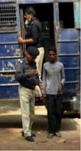 Nabeel Masih handcuffed