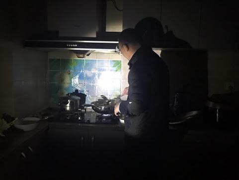 Minister Wu preparing dinner