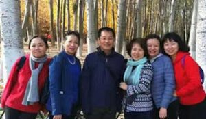 Jin Tianming and his wife with church members