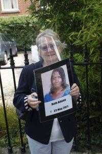 Ethel holding placard