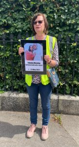 Pamela holding placard